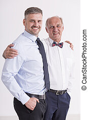 Mature man with his father - Man and his father standing...