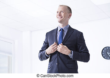 Man in suit in office area - Elegant man in suit standing in...