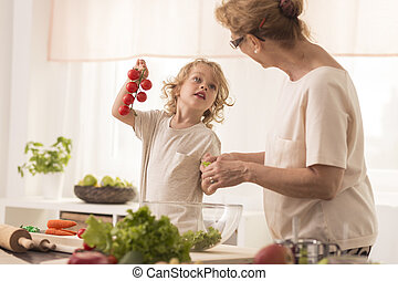 Grandma cooking with grandchild