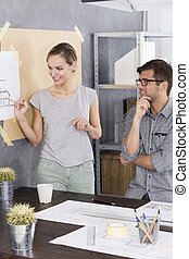 Woman is showing something on a drawing