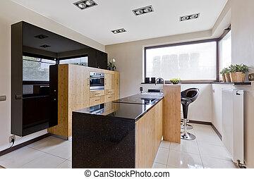 Light kitchen with dark details - Spacious villa kitchen...
