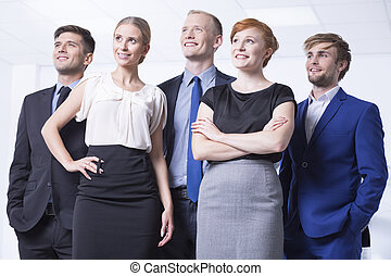 Smiled employees in elegant clothes - Group of smiled and...
