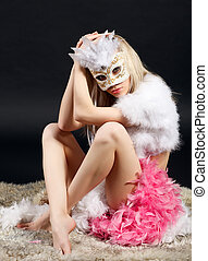 Anticipation. - Young attractive girl in a carnival mask and...