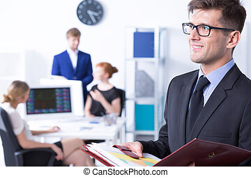 Elegant businessman and his employees - Work station with...