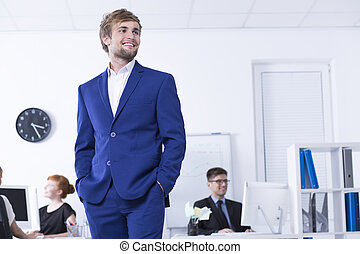 Man in blue suit in open space office - Young man in blue...