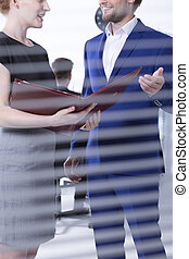 Talk between man and women at office - Young woman with...