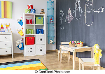 Child room with blackboard wall - View of child room with...