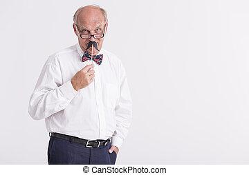 Eleder elegant man with paper moustache - Elder elegant man...