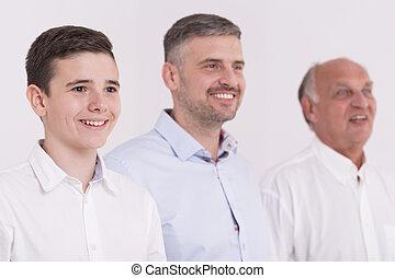 Portrait of three smiled men in elegant clothes