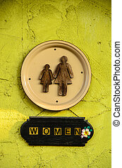Restroom sign - Chic women restroom sign on yellow-green...