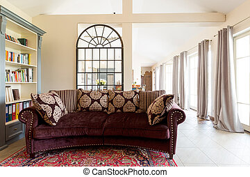 Old-fashioned elegant living room with cosy stylish sofa