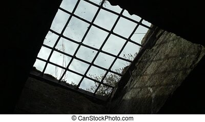 Prison sky behind bars - sky behind an iron grating over his...
