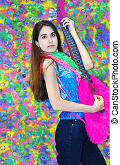 Cool Chick - Cool teenager holds funky pretend guitar and...