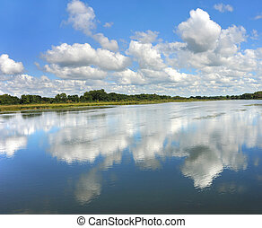Double View of Sky - Reflection of sky and clouds causes you...