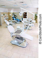 Interior of a dental medicine clinic , dental chair and...