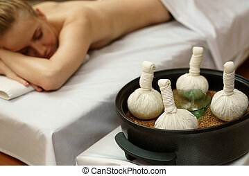 In spa. Traditional thai massage with salt bags