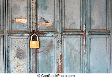 Metal lock on a blue door, vintage concept