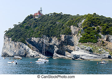 People on their boats were moored at island of Tino - Tino...