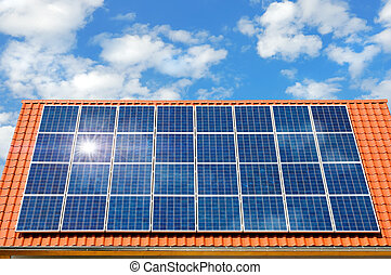 Solar panel on a roof - Roof with solar panel reflecting the...
