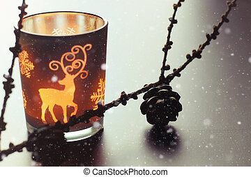 candle in glass fir-cone