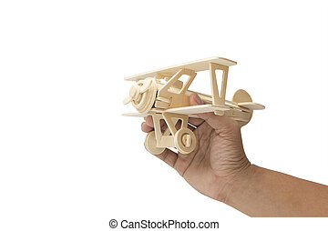wooden plane in hand isolated