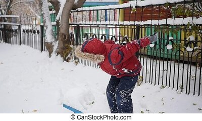 a child jumps into the snow