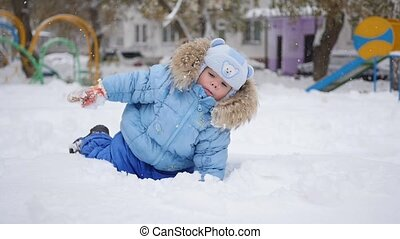 a children plays in the snow