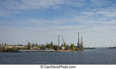 cargo cranes Bay sea barge boat bridge a small town water -...