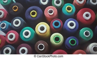 Sewing Threads On Spool. Closeup. Colorful spools of thread...