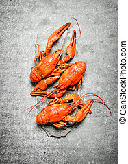 Flavorful boiled crawfish. On a stone background.