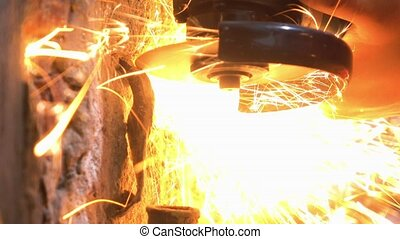 Man Used Circular Cutting Machine is Cut the Pipe with Lot of Sparks