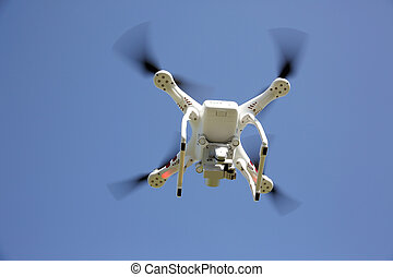 White drone quad copter - White drone copter with flying in...