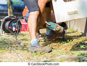 Safe hard work - Trained handyman cutting with flex...