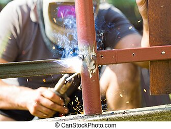Welding fence metal parts - Metal fence assembly by manual...