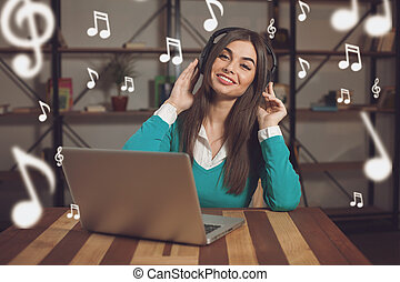 Smilling woman and headphones - Smilling woman with...