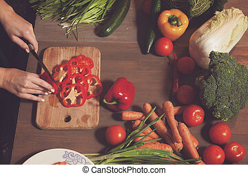 Rings of red pepper - At the table with vegetables red...