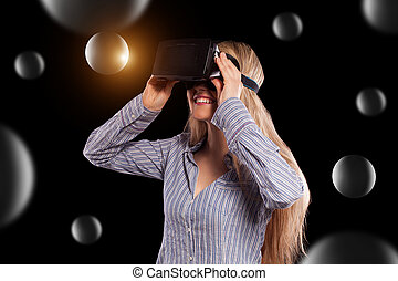 Woman in virtual reality headset - Intrigued woman in grey...