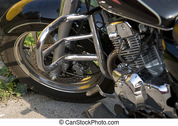 detail of sporting motorcycles in the parking lot is
