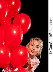 Pretty woman in blouse with red balloons - Happy young blond...