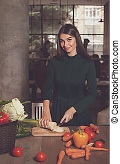 Smilling woman and onion - Smilling woman is cutting an...