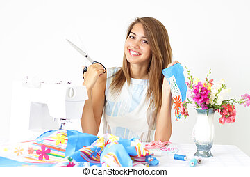Girl and a sewing machine on a light background