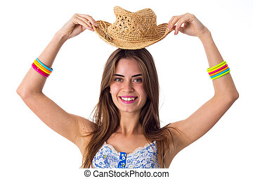 Smiling woman holding her hat