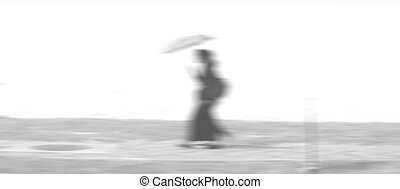 People walking in the street on a day motion blurred