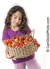 girl holding a basket of tomatoes