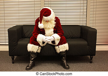 Sad and depressed Santa Claus waiting for christmas job...