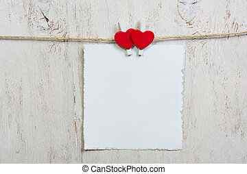 note attached with two red hearts