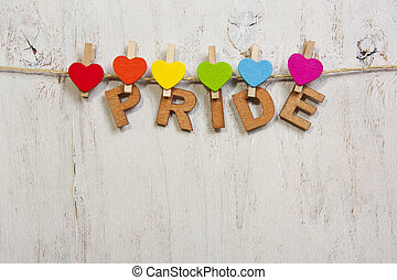 word pride attached rainbow hearts