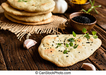 Indian Naan bread - Traditional Indian Naan bread with...