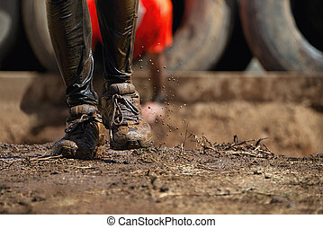 Mud race runners,detail of the legs in the background...
