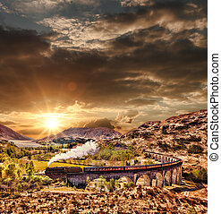 Glenfinnan Railway Viaduct in Scotland with the Jacobite...